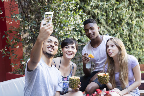 Happy friends having cocktails and taking a selfie outside - LFEF00084