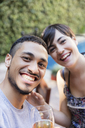 Selfie of smiling young couple outdoors - LFEF00090