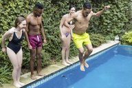 Happy friends jumping into swimming pool - LFEF00102