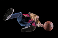 Basketball player against black background seen from below - STSF01468