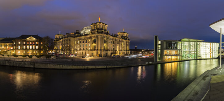 Germany, Berlin, Reichstag and Paul Loebe Government Building at Spree river in the evening - FOF09887