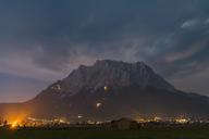 Austria, Lermoos, Ehrwalder Becken, Ehrwald with midsummer fire, Zugspitze - FOF09922