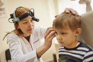 ENT physician examining ear of a boy - ZEDF01229