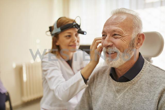 ENT physician examining ear of a senior man - ZEDF01232 - Zeljko Dangubic/Westend61