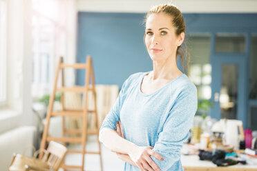 Woman refurbishing her new home, taking a break - MOEF00910