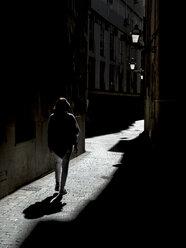 Spain, Palma de Mallorca, woman walking in alley - EJWF00857
