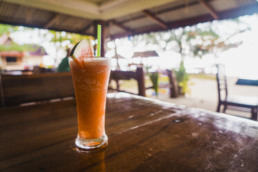 Thailand, glass with refreshing drink on table - KKAF00889