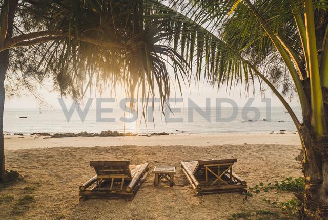 Thailand, Phi Phi Islands, Ko Phi Phi, sun loungers on the beach in backlight - KKAF00895