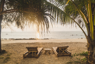 Thailand, Phi Phi Islands, Ko Phi Phi, sun loungers on the beach in backlight - KKAF00895