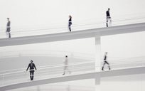 Blurred business people walking on elevated walkways - CAIF00013