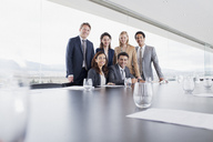 Portrait of smiling business people in conference room - CAIF00019