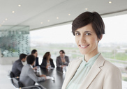 Portrait of smiling businesswoman in conference room - CAIF00028
