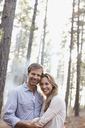 Portrait of smiling couple in woods - CAIF00049
