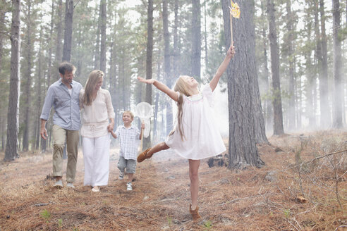 Happy family  with butterfly nets in sunny woods - CAIF00058