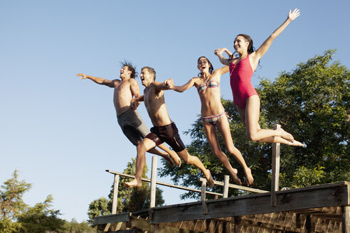 Friends jumping off dock - CAIF00127