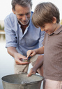 Grandfather and grandson with frog and bucket - CAIF00133