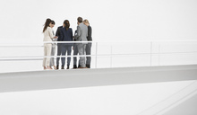 Business people meeting on elevated walkway - CAIF00214