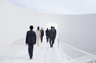 Business people walking toward doorway - CAIF00226