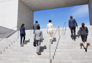 Business people ascending urban stairs - CAIF00229