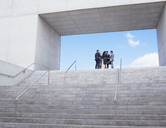 Business people meeting at top of urban stairs - CAIF00244