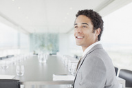 Smiling businessman in conference room - CAIF00313