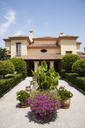 Potted plants in formal garden outside villa - CAIF00367