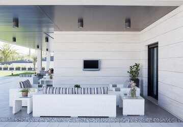 Sofa and television on luxury patio - CAIF00376