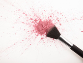 Makeup brush and pink blush powder splatter - CAIF00394