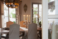 Candelabra on table in luxury dining room - CAIF00626