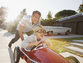 Father pushing son in go cart - CAIF00656