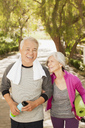 Older couple walking together outdoors - CAIF00716