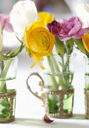 Close up of flower bunches in glasses - CAIF00746