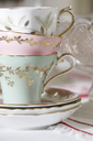 Close up of ornate teacups stacked together - CAIF00755