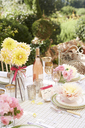 Table set for wedding reception outdoors - CAIF00767