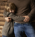 Smiling son hugging father - CAIF00845