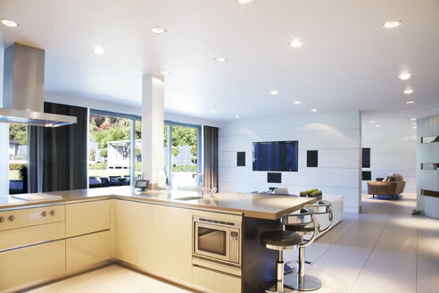 Kitchen and living room in modern home - CAIF01007
