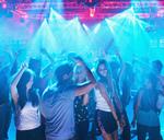 People dancing on dance floor of nightclub - CAIF01058