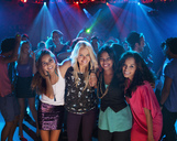 Portrait of smiling women on dance floor at nightclub - CAIF01085