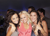 Portrait of smiling women in nightclub - CAIF01100