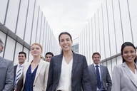 Portrait of smiling business people walking - CAIF01136