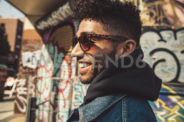 Portrait of smiling stylish young man outdoors - SUF00468