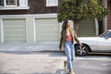 Young woman crossing the street - SUF00501