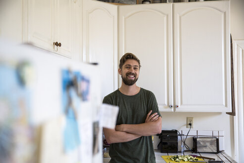 Portrait of smiling man in kitchen at home - SUF00516