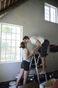 Young couple kissing during renovating their home - ECPF00193