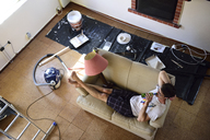 Young man having a break from renovating his home - ECPF00199