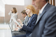 Business people using laptop and digital tablet - CAIF01234