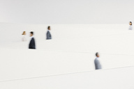 Blurred business people walking along modern staircase - CAIF01300
