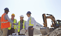 Business people shaking hands in quarry - CAIF01351