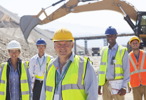 Business people standing in quarry - CAIF01369