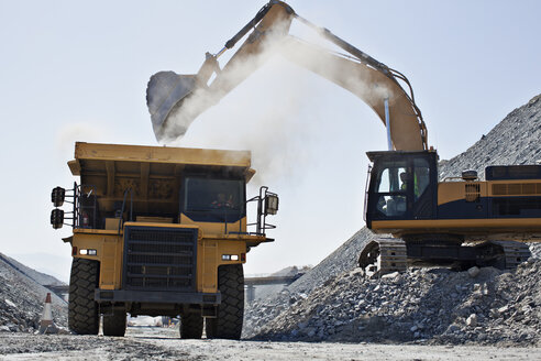 Digger and truck working in quarry - CAIF01375